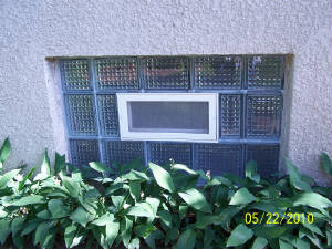Holler Glass Block , Kevin Holler is a glass block basement window installation expert.  He has been updating old mortared windows with translucent silicone joints which are more durable.  Kevin Holler has been rated number one in the Twin Cities Glass Block repair field.JPG